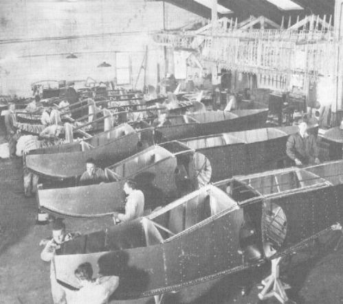 Model A floats lined up in the Baldwin plant