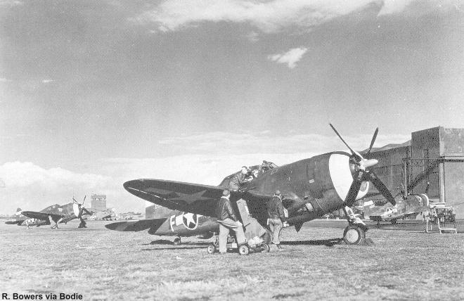 Early model P-47D's on a British airfield